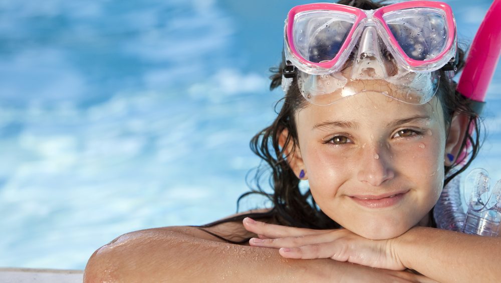 Girl with swimming goggles at an Orlando vacation home